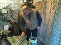 Stewart paints the trellis